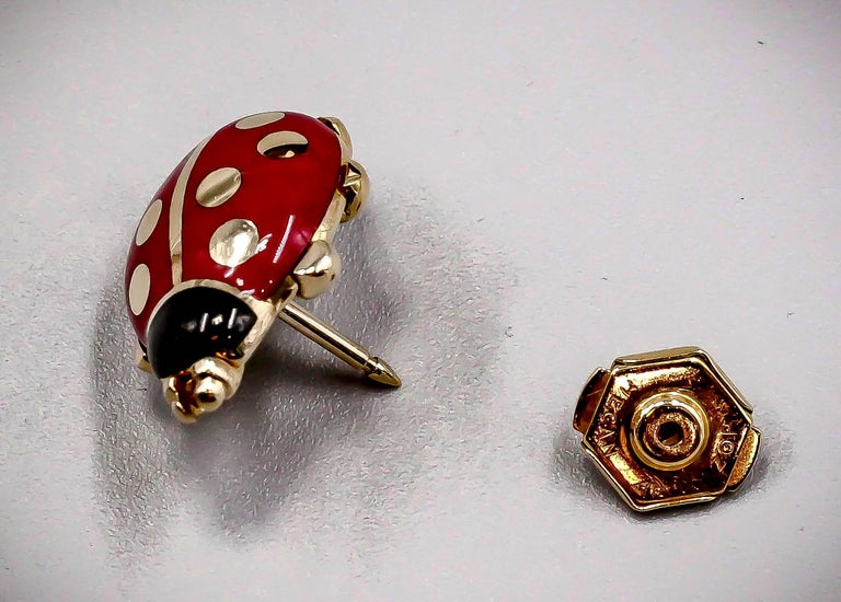 Whimsical 18K yellow gold and two color enamel pin by Cartier.  Designed as a ladybug, it features red and black enamel over 18k gold.  Circa 1990.  Hallmarks: Cartier, 1990, 750, reference numbers.