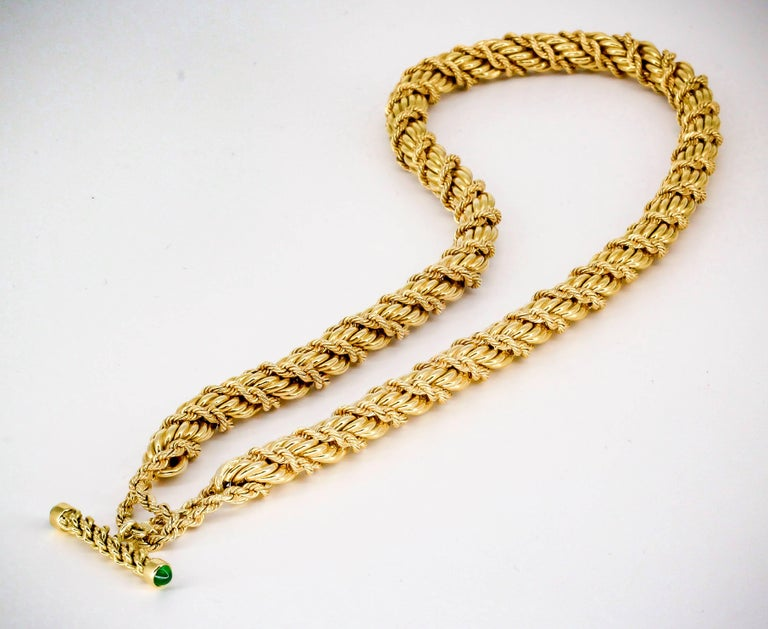 Rare and unusual emerald and 18K gold necklace by Tiffany & Co. Schlumberger, circa 1990s. Necklace feature a large twisted rope, with intertwined twisted rope design; as well as a toggle closure with the bar set with rich green cabochon