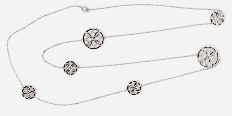 Stylish diamond and 18K white gold long necklace by Ivanka Trump. It features several small and large circles with various patterns, encrusted with high grade round brilliant cut diamonds on the front and back of each, diamond weight approx. 5-6