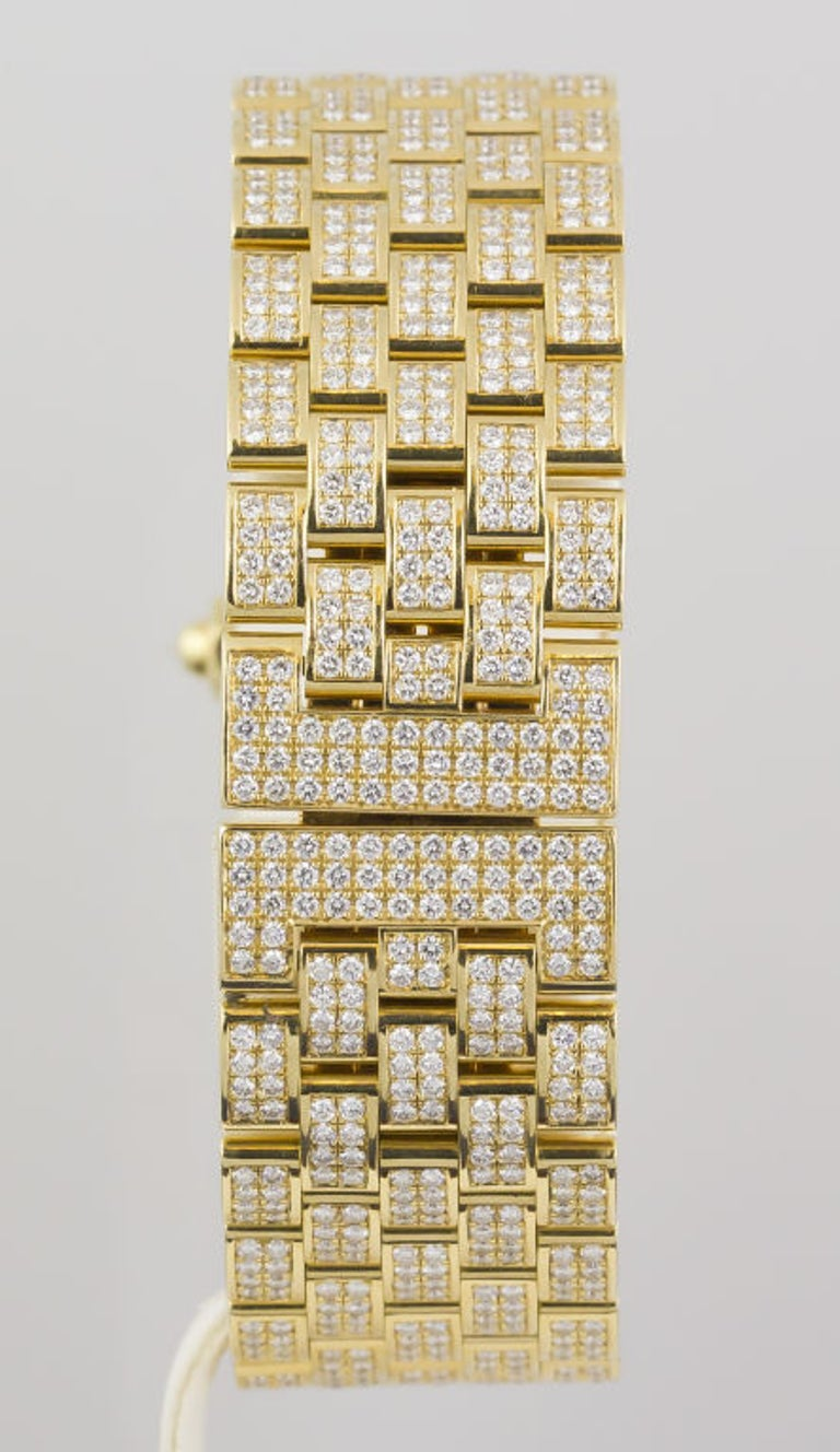 Important 18K yellow gold and diamond ladies wrist watch by Chaumet. It features a brick-like bracelet and is extremely comfortable because it contours very well with anyone's wrist. Set with brilliant high-grade round cut diamonds of approx.
