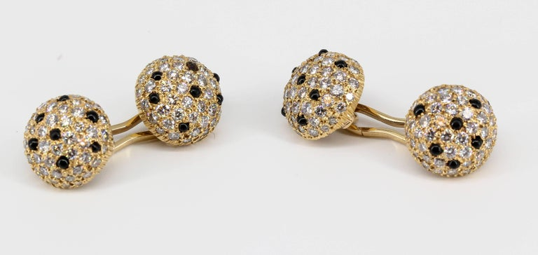Handsome onyx, pave diamond and 18K yellow gold cufflinks. They feature high grade pave cut diamonds of approx. 4-5 carats.