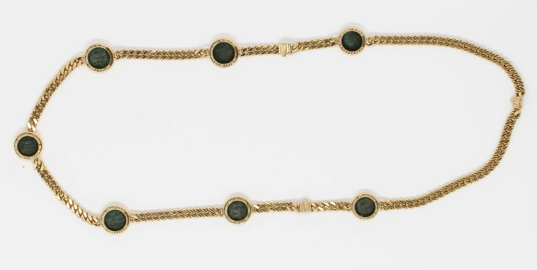 Rare and unusual 18K yellow gold and ancient coin link necklace and bracelet combination, by Bulgari circa 1970-80s. It features ancient Constantine II coins dating 316-337 A. D.  The Necklace combines with two bracelets to make one long necklace,
