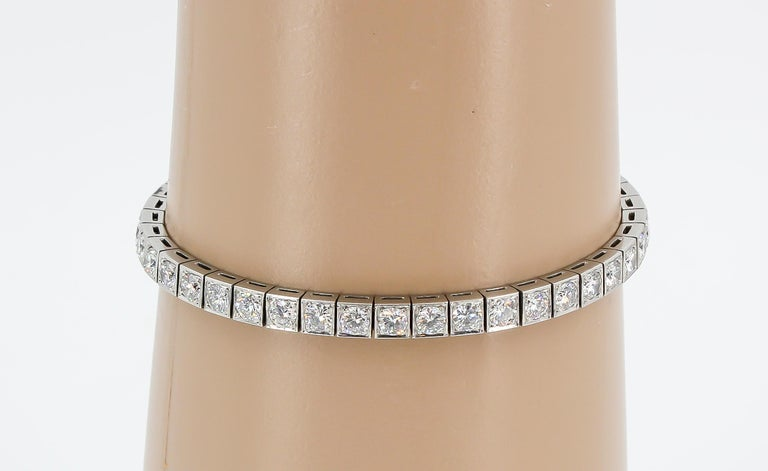 Timeless diamond and platinum tennis bracelet by Tiffany & Co, circa 1920s-30s.. This exquisite piece features very high grade round brilliant cut diamonds, approx 7.0cts total weight. Approx. 7