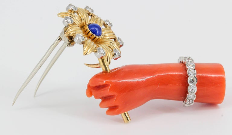 Cartier Lapis, Diamond, Coral Platinum and Gold Hand Holding Flower Brooch In Good Condition For Sale In New York, NY