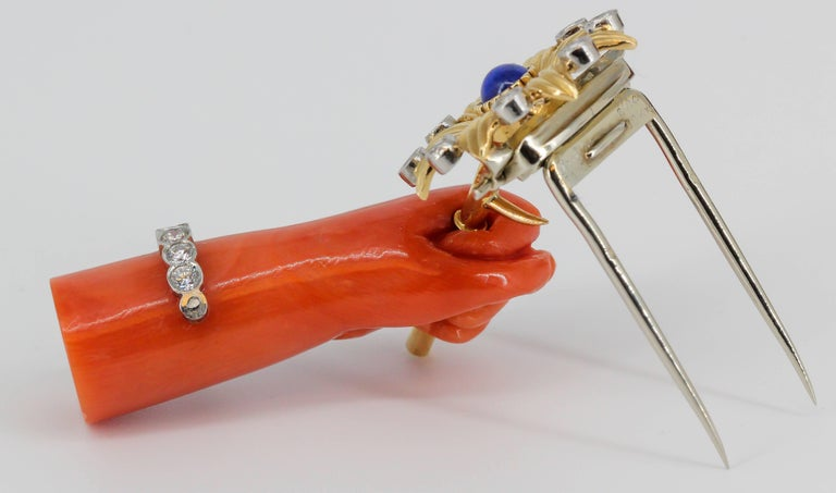 Cartier Lapis, Diamond, Coral Platinum and Gold Hand Holding Flower Brooch For Sale 1