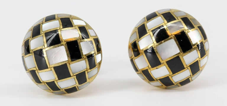 Handsome inlaid black jade and mother of pearl over 18K yellow gold cufflinks by Tiffany & Co., designed by Angela Cummings. They feature a round button style design with checkered style inlaid jade and mother of pearl.   Hallmarks: Tiffany & Co,
