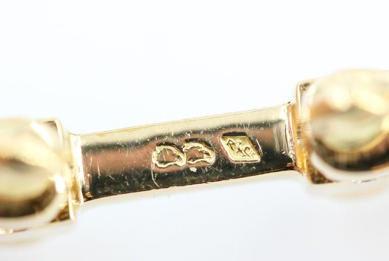 Hermès 18 Karat Yellow Gold Stirrup Folding Cufflinks For Sale 1