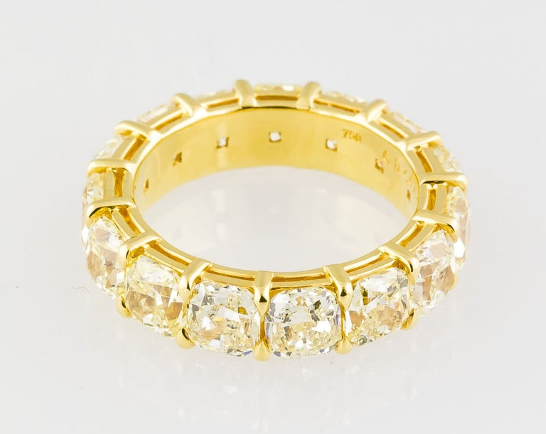 Vibrant fancy yellow diamond and 18K yellow gold band ring. Features high quality cushion-cut natural fancy yellow diamonds, VS-SI clarity range, for a total weight of approx. 8.0cts. Size 7. Hallmarks: 750, reference numbers