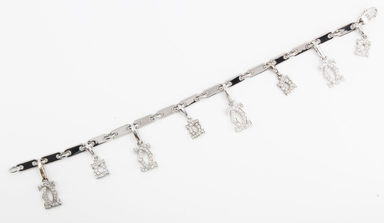 CARTIER Diamond and White Gold Charm Bracelet In Excellent Condition For Sale In New York, NY