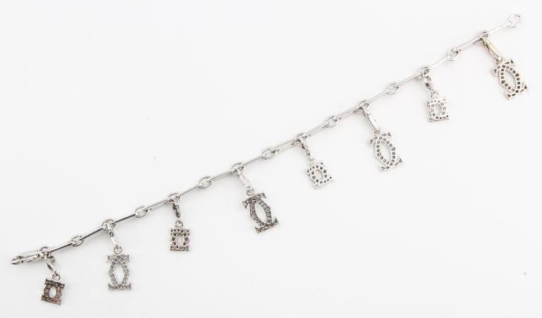 Women's CARTIER Diamond and White Gold Charm Bracelet For Sale