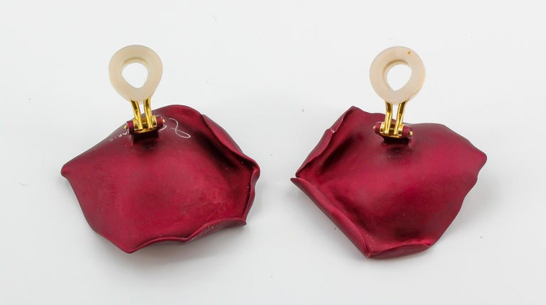 Rare and unusual brushed aluminum and 18K yellow gold clip-on earrings by JAR, Joel Arthur Rosenthal. They feature a rich bordeaux/burgundy matte finish and resemble rose petals, hence the name.   Hallmarks: JAR, Paris, French 18k gold assay mark