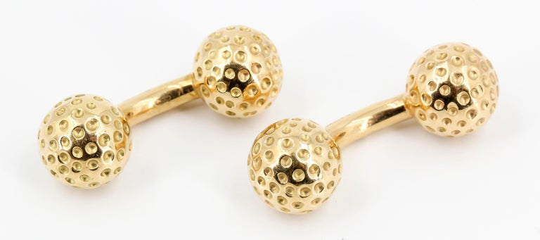 Handsome 18K yellow gold dumbbell cufflinks in the likeness of golf balls, made by Hermes.   Hallmarks: Hermes, Made in France, 18k, French 18K gold assay mark.