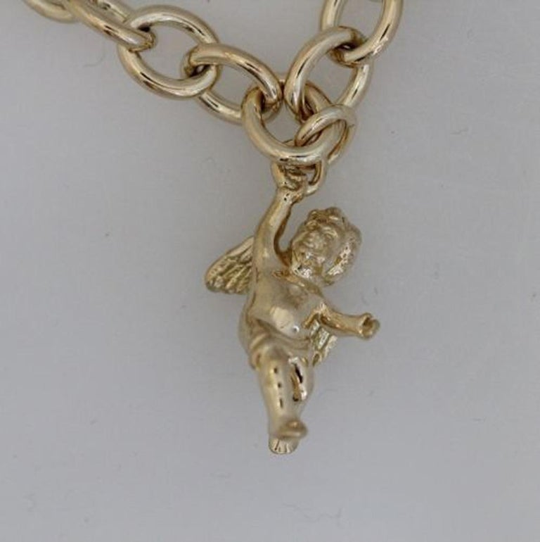Tiffany and Co. CHERUB Charm 18k Solid Yellow gold , price is only for the charm no necklace.  A Tiffany gold charm tells a story. Cherub charm in 18k gold.   Apprx 2.5 inches tall by 1.5 inches wide.  Guaranteed Authentic Tiffany & Co  SKU