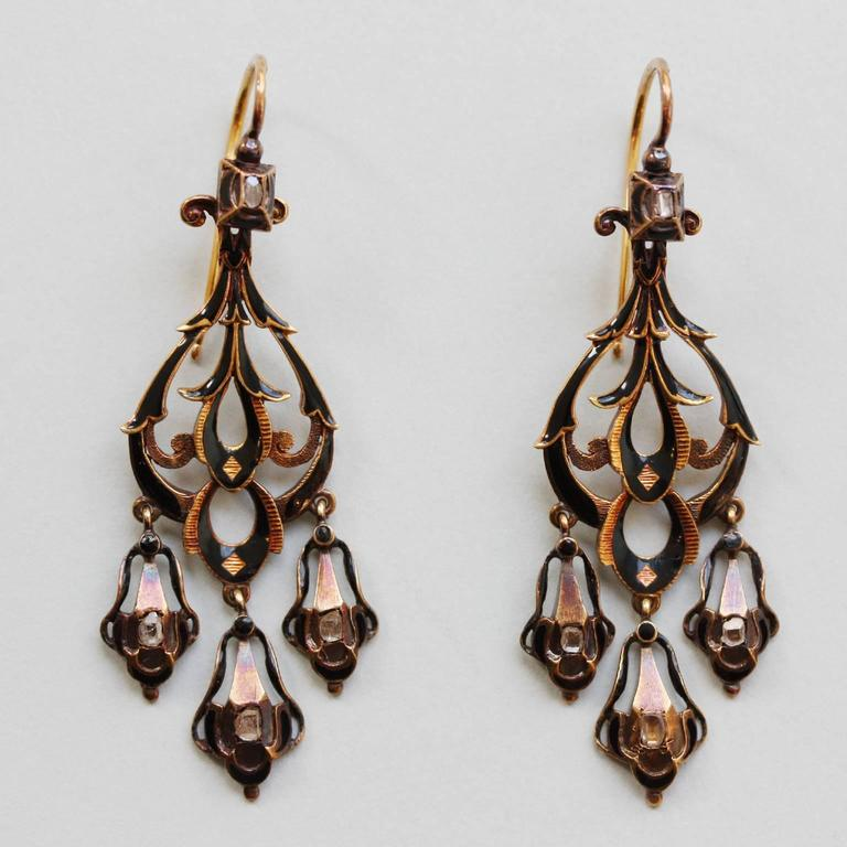 A pair of 18 carat gold neo renaissance earrings set with small table cut diamonds, both sides decorates with black enamel, 19th century, France.
