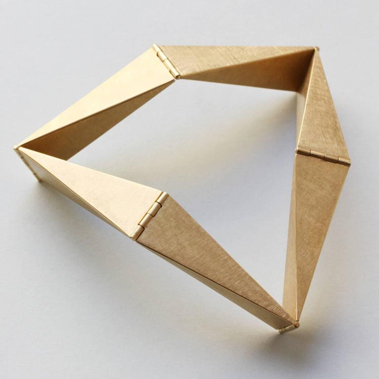 A geometrical 18 carat gold bracelet by Anne Roose Regenboog.  weight: 60 grams size: very small