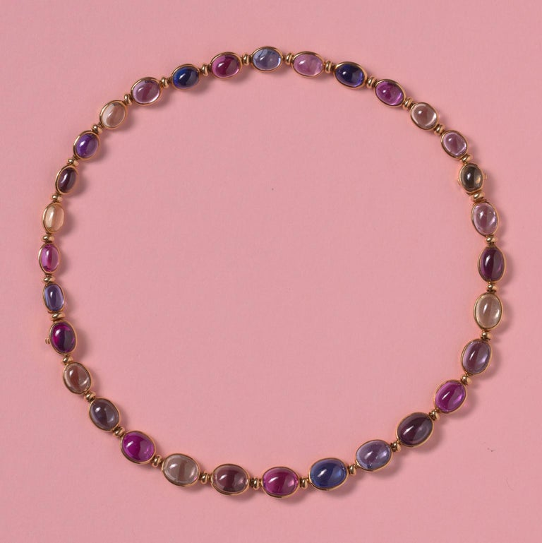 An 18 carat gold necklace that can be worn as two bracelets, each link is set with a different color natural cabochon cut sapphire, signed: Bulgari, and on each bracelet the amount of carats is noted 41.13 and 30.12.  weight: 36.77 gram length