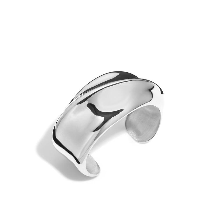 AGMES Sterling Silver Sculptural Twisted Cuff. Handmade in NYC.   Inspired by urban landscapes, architecture and modern art, the collection creates a feminine geometry expressed through clean lines and sculptural silhouettes.