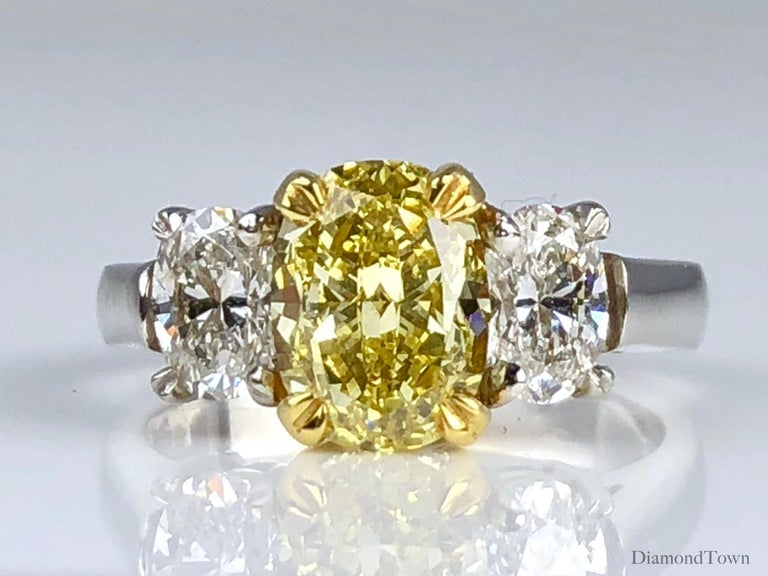 Contemporary GIA Certified 2.01 Carat Natural Fancy Intense Yellow Diamond Ring in Platinum For Sale