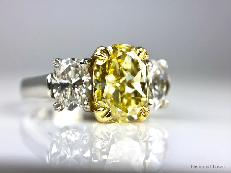 Oval Cut GIA Certified 2.01 Carat Natural Fancy Intense Yellow Diamond Ring in Platinum For Sale
