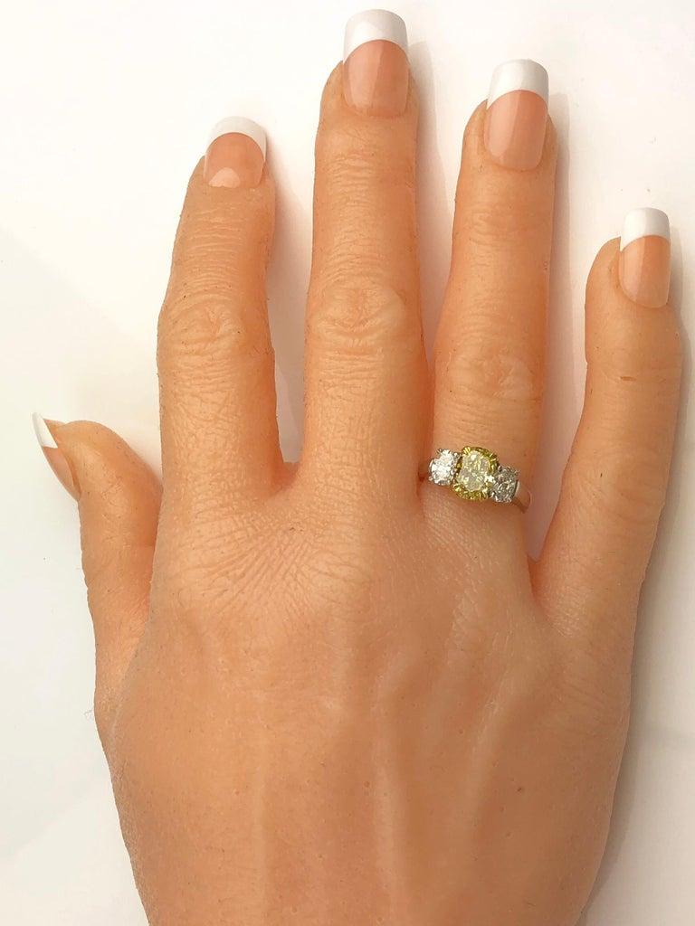 Women's GIA Certified 2.01 Carat Natural Fancy Intense Yellow Diamond Ring in Platinum For Sale
