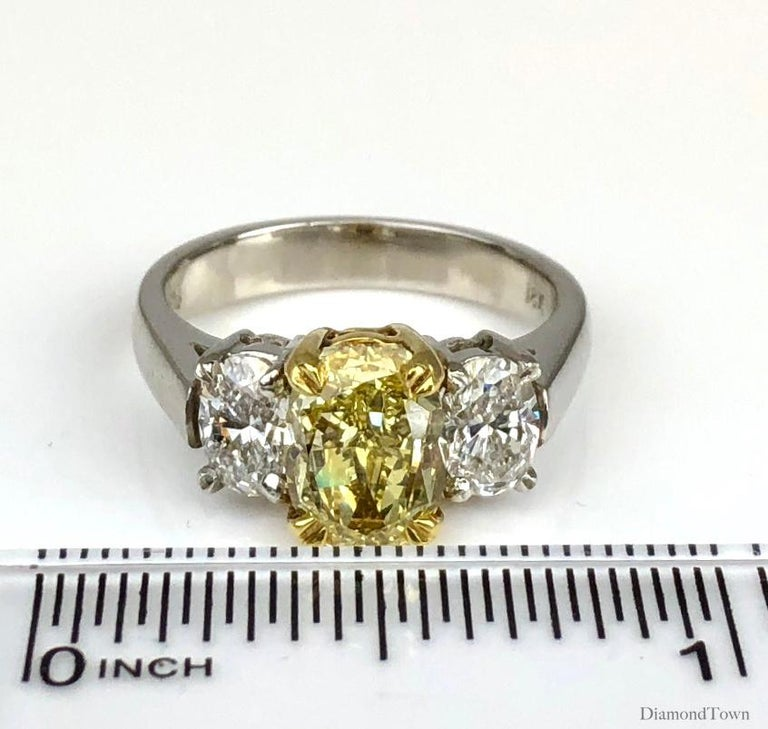 GIA Certified 2.01 Carat Natural Fancy Intense Yellow Diamond Ring in Platinum For Sale 1