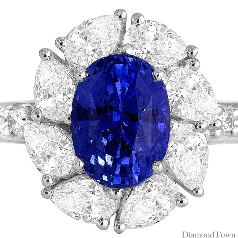 Contemporary 2.54 Carat Oval Cut Vivid Blue Ceylon Sapphire and Diamond Ring in White Gold For Sale