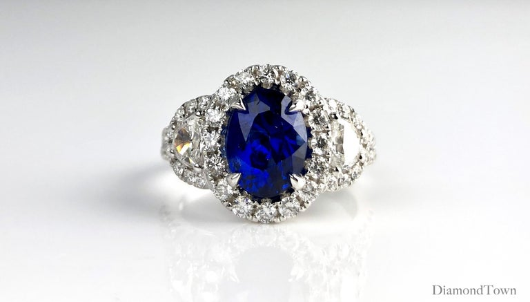 Women's 2.26 Carat Oval Cut Vivid Blue Ceylon Sapphire and Diamond Ring in White Gold For Sale