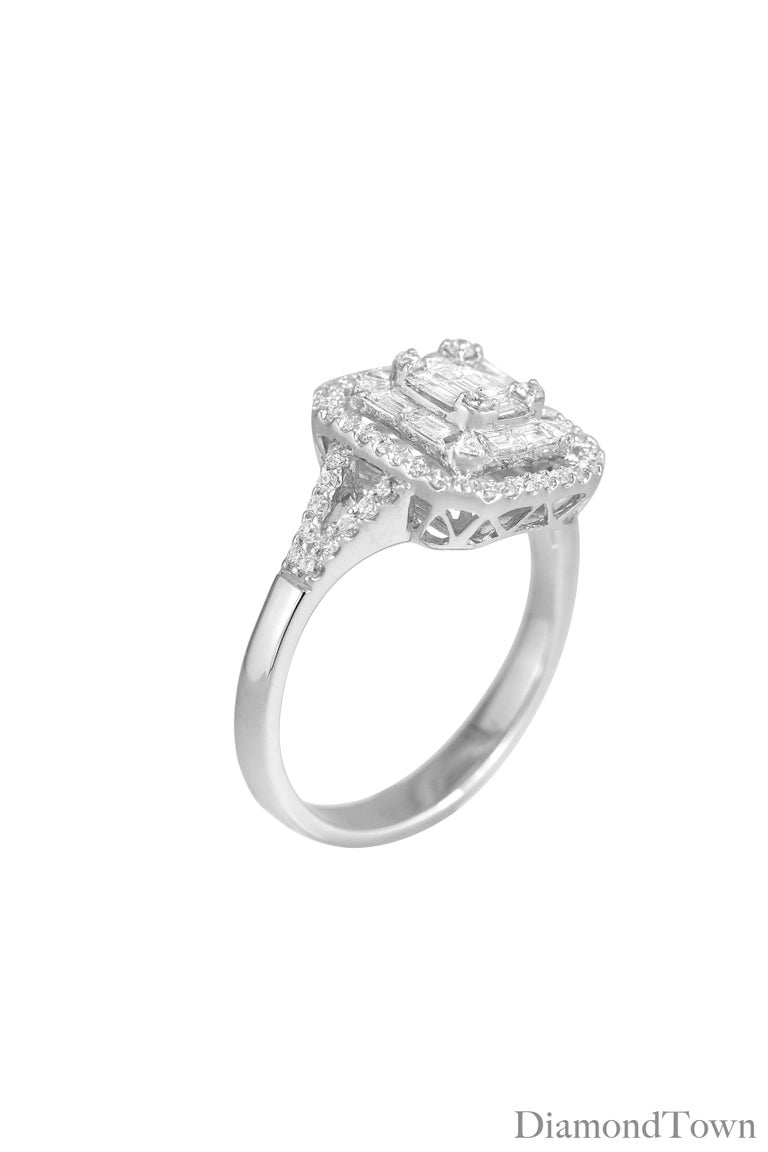 This ring features a center cluster of baguettes, surrounded by a halo of round diamonds, set in 18k White Gold. Total diamond weight 0.86 Carats.  Ring size 6.5, with room to size up or down.  Many of our items have matching companion items. Please