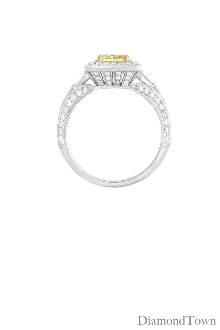 This ring features a GIA-certified 1.22 Carat Radiant Cut Natural Fancy Yellow Diamond center, surrounded by intricate milgrain work and a halo of round white diamonds, bringing the total diamond weight to 1.97 carats.   Center is GIA certified