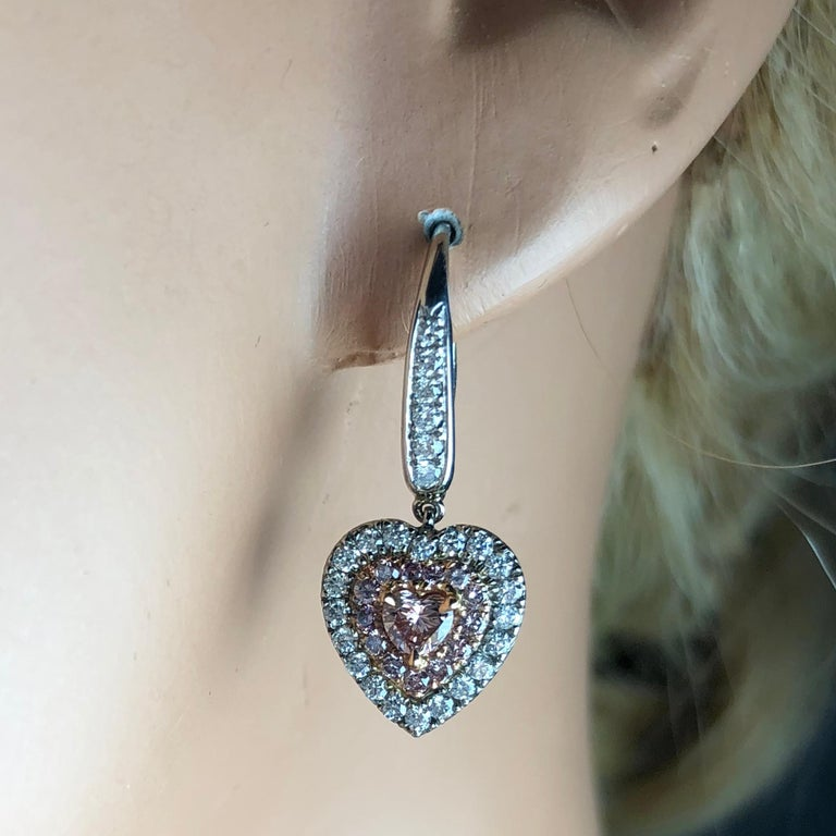 Contemporary 1.15 Carat Natural Fancy Pink Diamond Heart Earrings in White Gold and Pink Gold For Sale