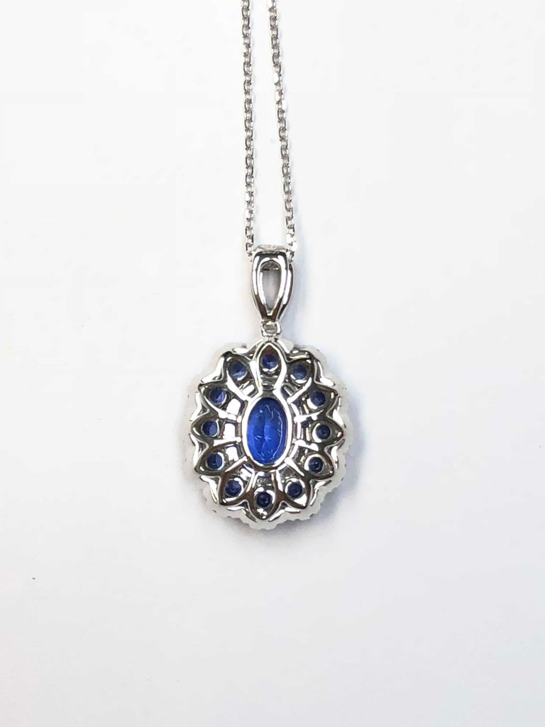 Contemporary 1.91 Carat Blue Sapphire and White Diamond Flower Pendant in 18 Karat White Gold For Sale