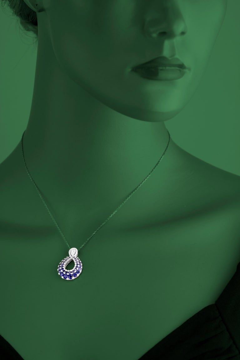 Contemporary 2.09 Carat Blue Sapphire and Drop Diamond Pendant in 18 Karat White Gold For Sale