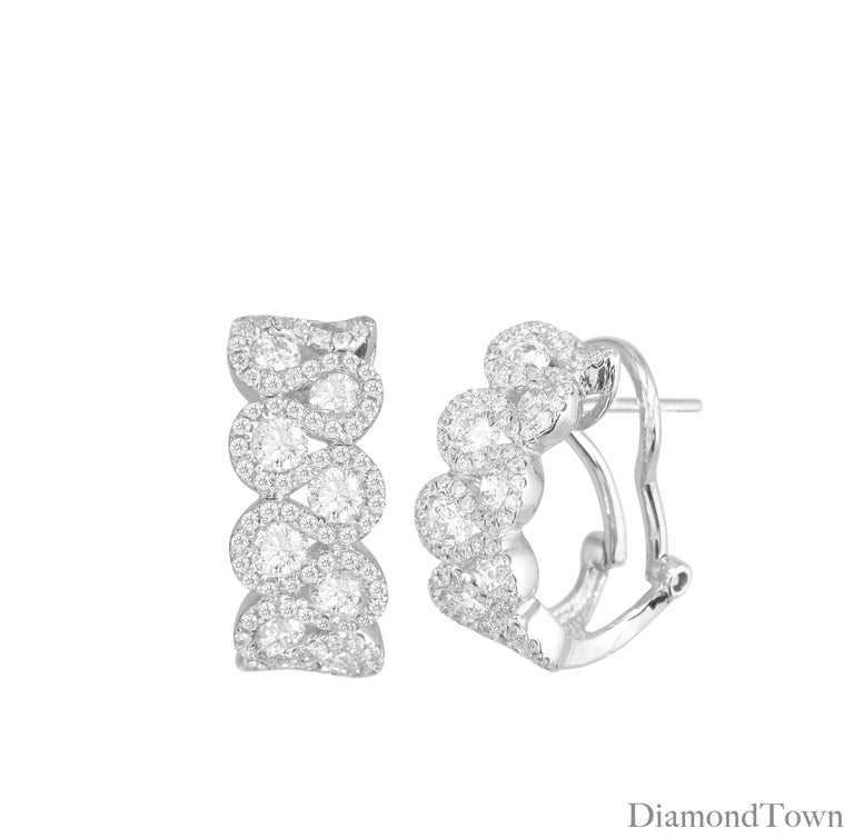 Bright diamond earrings each featuring eight beautiful round cut diamonds wrapped among a looping trail of smaller diamonds. Total carat weight 2.00 carats, set in 18k White Gold.  Securely and comfortably closes with a lever-back.  Many of our