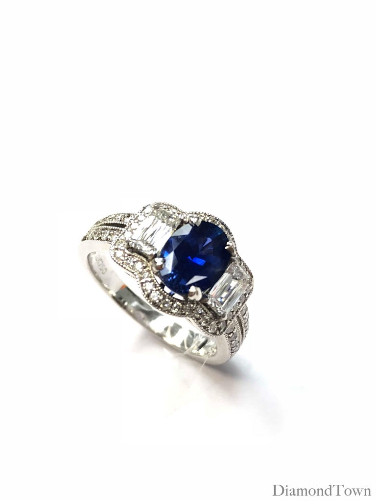 Contemporary GAL Certified 1.44 Carat Oval Cut Blue Sapphire and Diamond Cocktail Ring For Sale