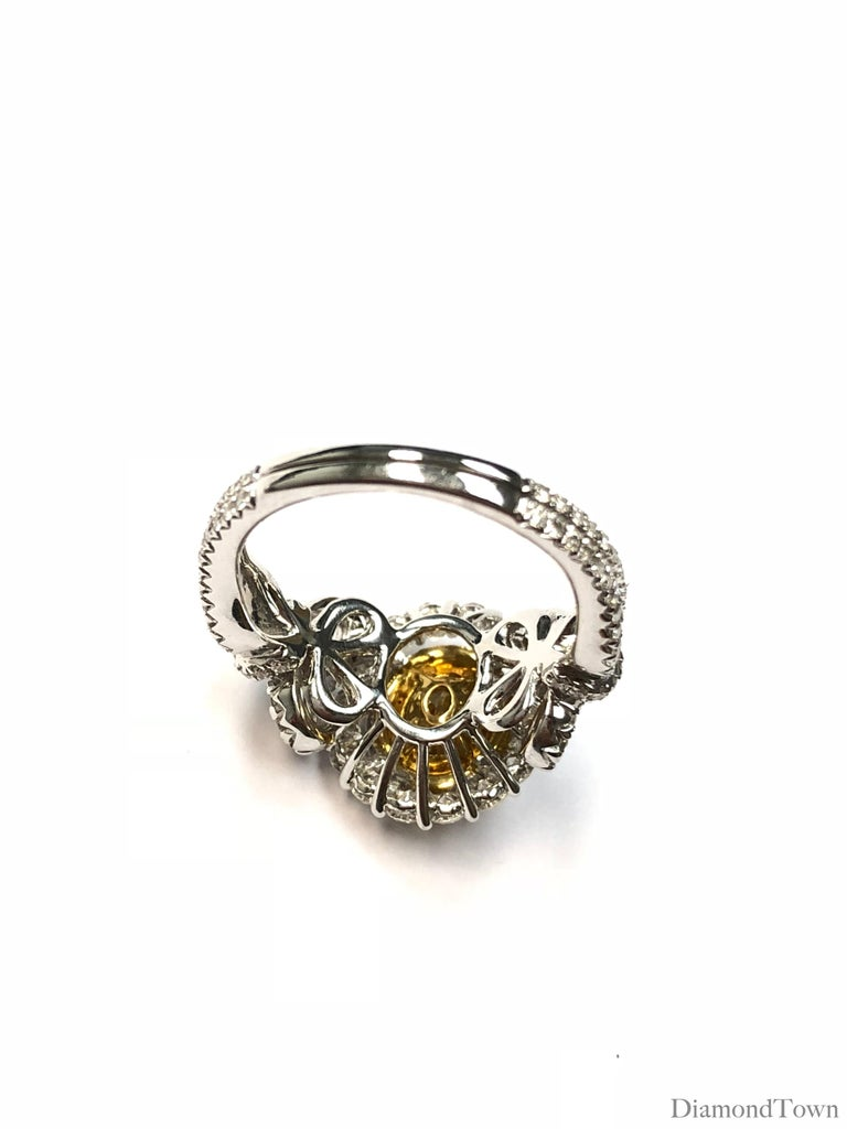 Women's GIA Certified 0.98 Carat Oval Cut Natural Fancy Intense Yellow SI1 Diamond Ring For Sale