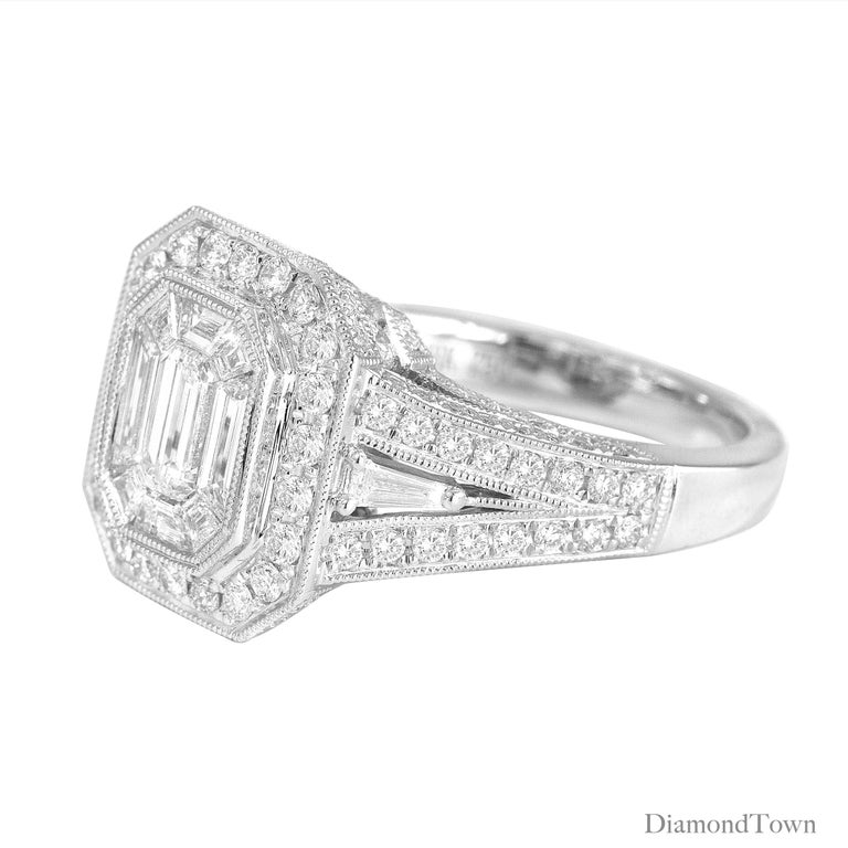 This ring features a center cluster of baguettes totaling 0.81 carats. An additional halo of round diamonds, and diamonds down the shank and all sides of the raised setting bring the total diamond weight to 1.66 carats. Intricate milgrain work and