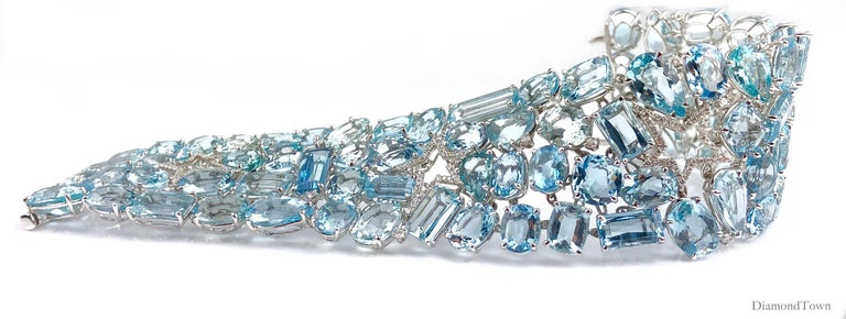 This gorgeous bracelet features 111.28 Carats Aquamarine alongside 0.94 Carats Diamonds. The mixed shape stones include ovals, baguettes, and pear shapes. A star cutout made of diamonds gives a lucky accent.   Set in 18k White Gold.  There is a