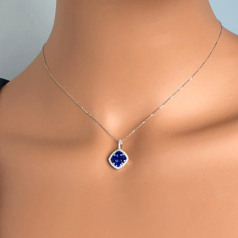 Contemporary 1.09 Carat Sapphire and 0.13 Carat Diamond Halo Pendant in 18 Karat White Gold For Sale