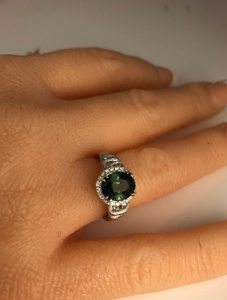 Women's 2.86 Carat Oval Cut Forest Green Sapphire and 0.87 Carat Diamond Ring For Sale
