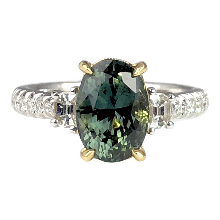 2.90 Carat Oval Cut Exotic Forest Green Sapphire and 0.57 Carat Diamond Ring For Sale