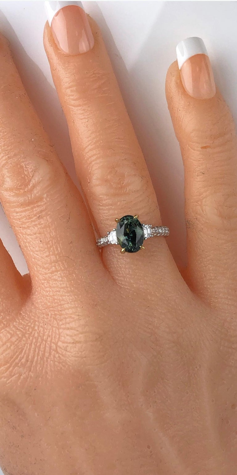 Contemporary 2.90 Carat Oval Cut Exotic Forest Green Sapphire and 0.57 Carat Diamond Ring For Sale