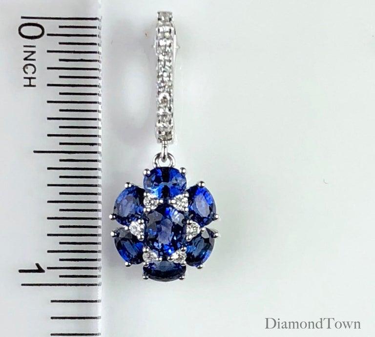 Women's 3.42 Carat Blue Sapphire Dangle Flower Earrings in 18 Karat White Gold For Sale