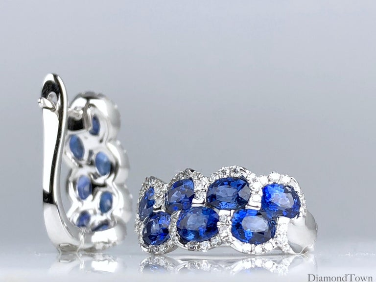 These lever-back earrings sparkle with seven oval cut sapphires per earring (total weight 2.88 carats), nestled among a trail of round white diamonds (total diamond weight 0.36 carats). Set in 18k white gold.  There is a seasonal promotion available