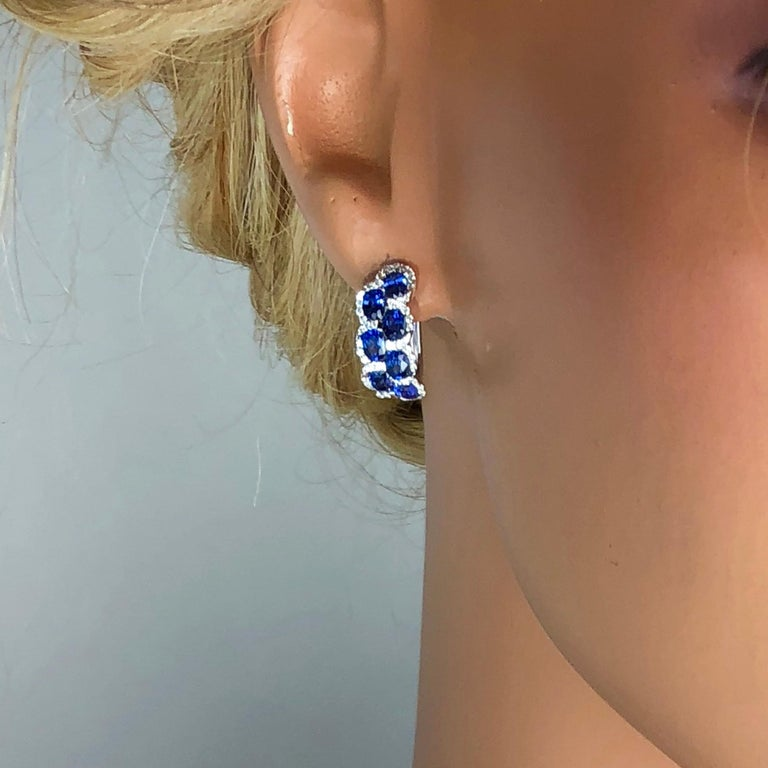 2.88 Carat Oval Cut Sapphire Lever-Back Earrings in White Diamond Halo In New Condition For Sale In New York, NY