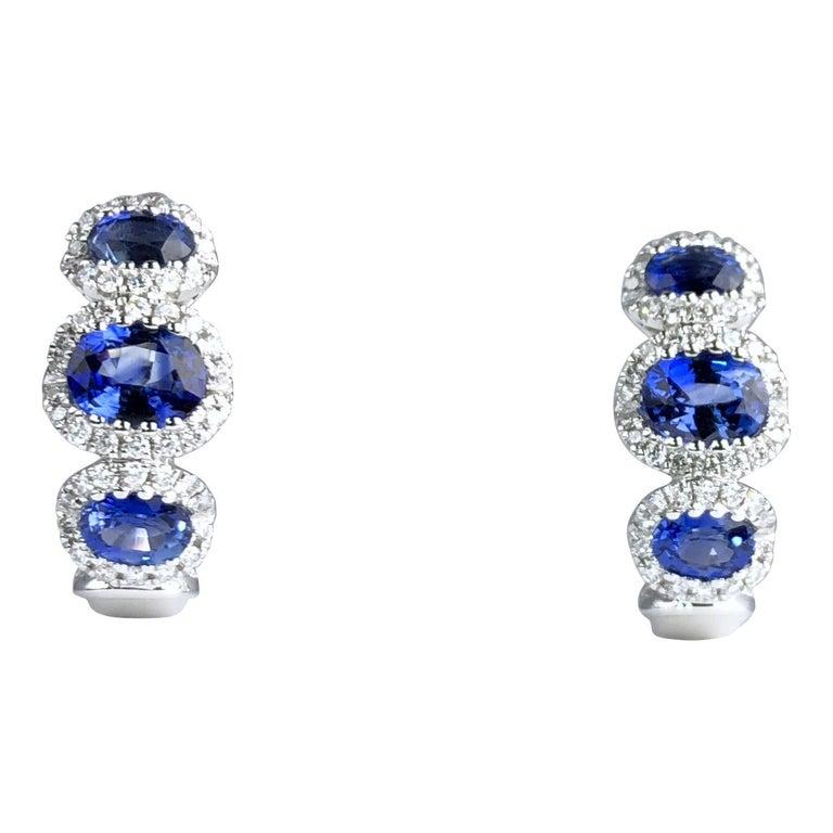 1.70 Carat Vivid Blue Sapphire and 0.31 Carat Diamond Lever-Back Stud Earrings For Sale