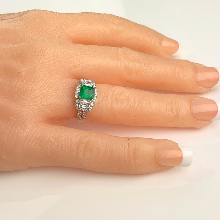 Women's 1.10 Carat Colombian Emerald and 1.03 Carat Diamond Ring in 18 Karat White Gold For Sale