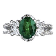 1.21 Carat Oval Cut Fine Emerald and 0.64 Carat Diamond Ring in 18 Karat Gold
