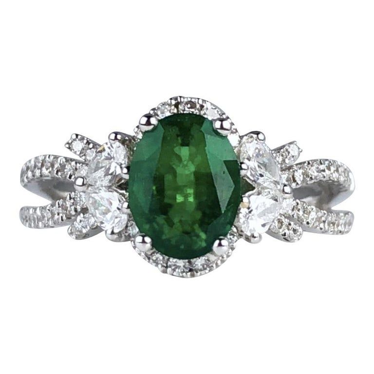 1.21 Carat Oval Cut Fine Emerald and 0.64 Carat Diamond Ring in 18 Karat Gold For Sale