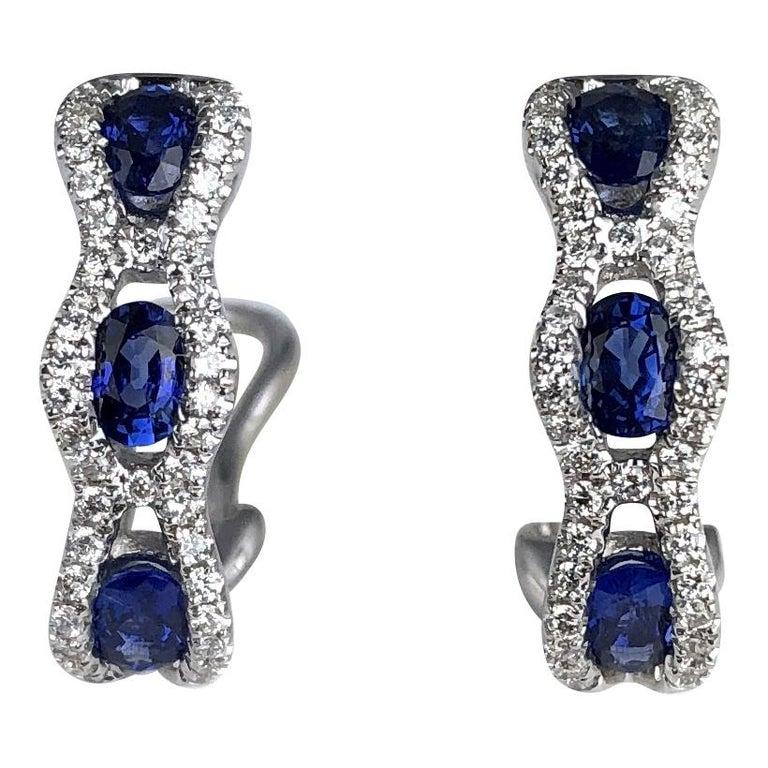 1.23 Carat Oval Cut Vivid Blue Sapphire and Diamond Earrings For Sale