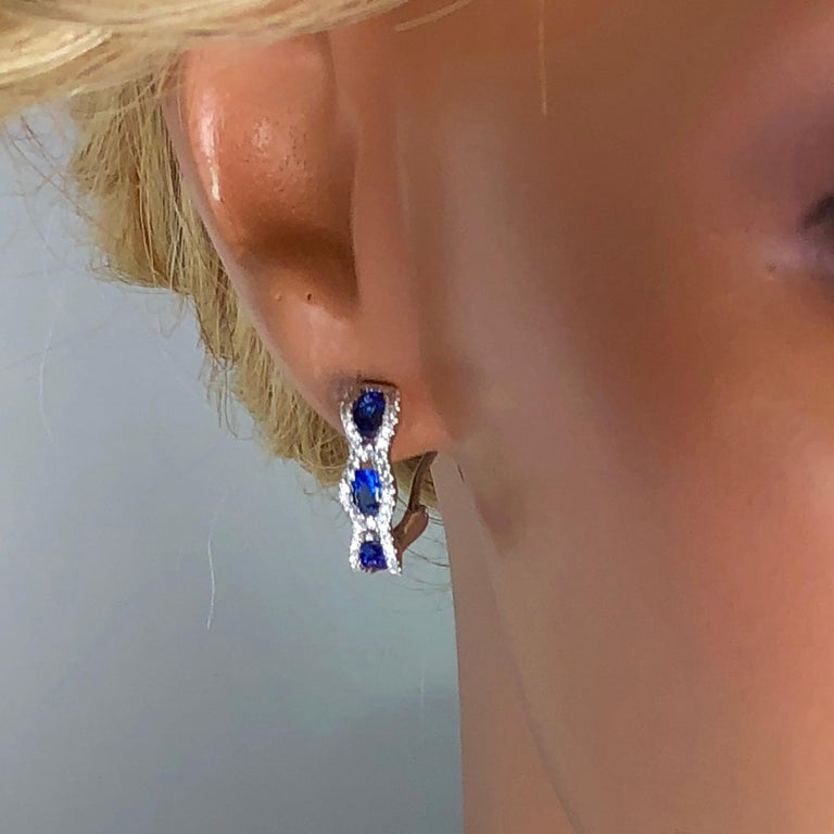 Contemporary 1.23 Carat Oval Cut Vivid Blue Sapphire and Diamond Earrings For Sale
